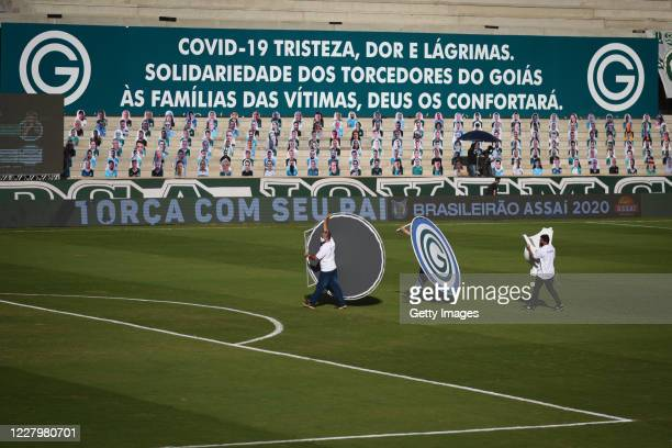 Staff members dismantle the structure of banners after the game between Sao Paulo and Goias as part of the 2020 Brasileirao Series A has been...