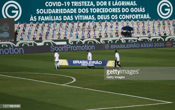 Staff members dismantle the structure of the banners after the game between Sao Paulo and Goias as part of the 2020 Brasileirao Series A has been...