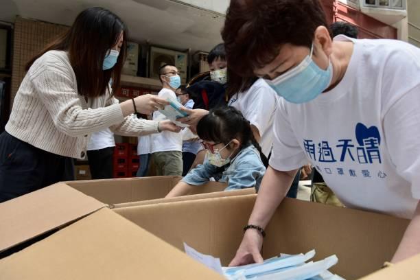 CHN: Charity Organizations Distribute Masks In Hong Kong