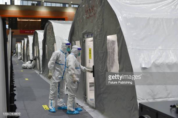 """Staff members enter the reagent preparation area of the """"Huo-Yan Laboratory"""" at venue 11 of Nanjing International Expo Center in Nanjing, East..."""