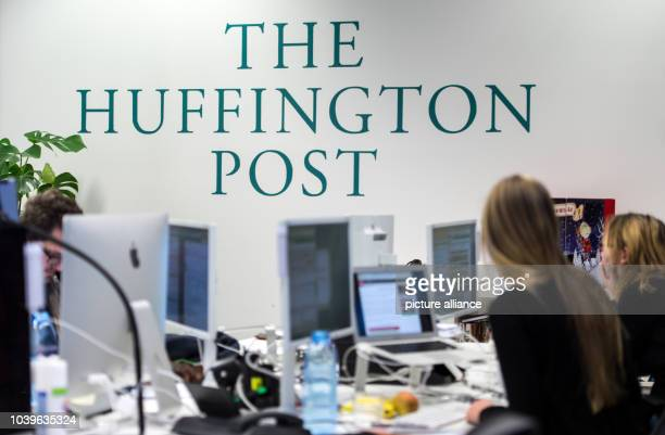 Staff members of online news publisher Huffington Post work in the editorial office of publisher BurdaForward in Munich, Germany, 7 December 2015....