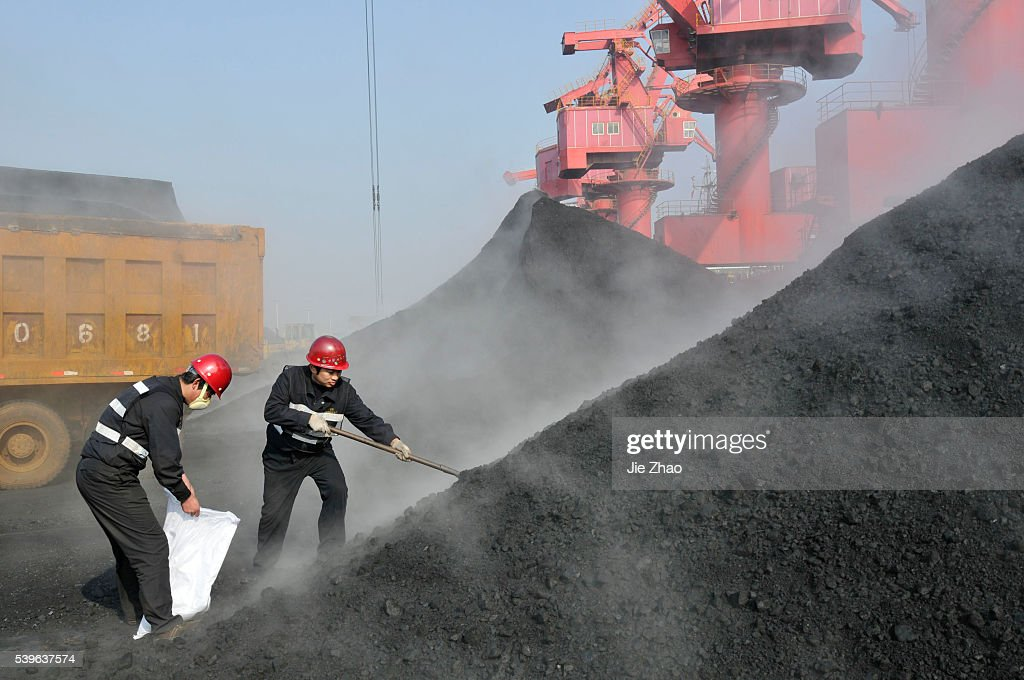 Staff members of quarantine service take a sample of coal imported from Australia in port of Rizhao : News Photo