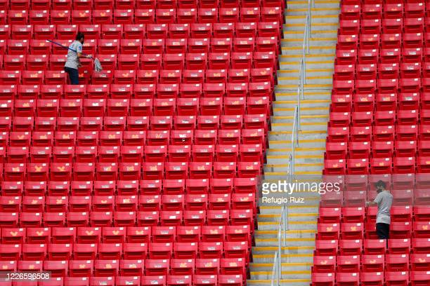 Staff members of the Akron Stadium clean the stands before the match between Atlas and Tigres UANL as part of the friendship tournament Copa GNP por...