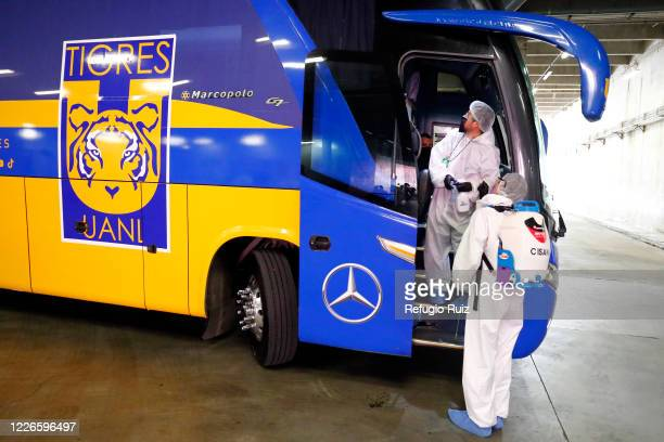 Staff members of the Akron Stadium sanitize a bus before the match between Atlas and Tigres UANL as part of the friendship tournament Copa GNP por...