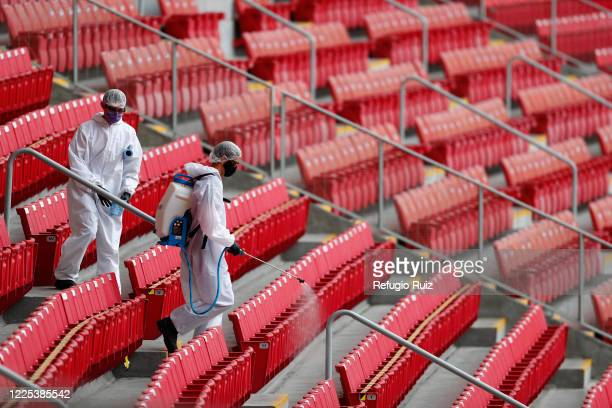 Staff members of the Akron Stadium sanitize the stands before the match between Atlas and Mazatlan FC as part of the friendly tournament Copa GNP por...