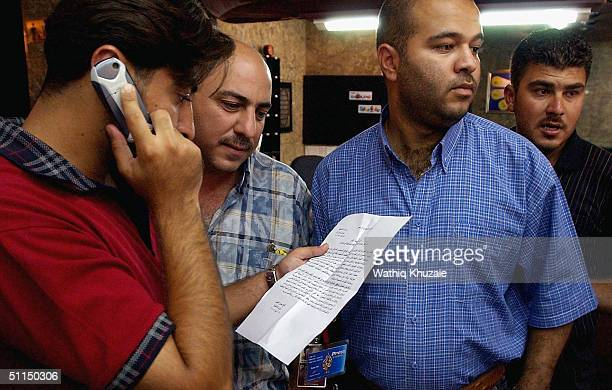 Staff members of the Arabic satellite channel Al Jazeera read a closure notice for their office August 7 2004 in Baghdad Iraq The Iraqi Prime...