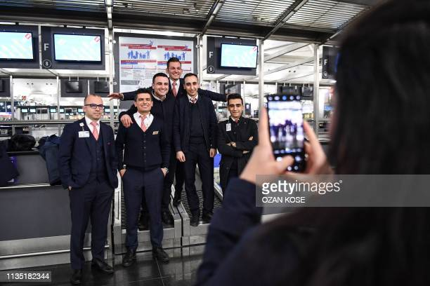 Staff members of the Ataturk Airport pose for a photo on the last day of flight operations of the Ataturk International airport late on April 5 2019...