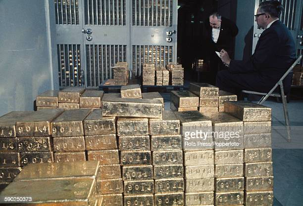 Staff members of the Federal Reserve Bank count foreign owned gold bars gold ingots or gold bullion in a secure basement depository vault in the...