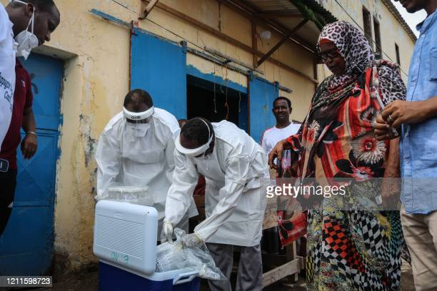Staff members of the Ministry of Health visit residents to take samples during the first day of mass testing for the COVID-19 coronavirus in Djibouti...