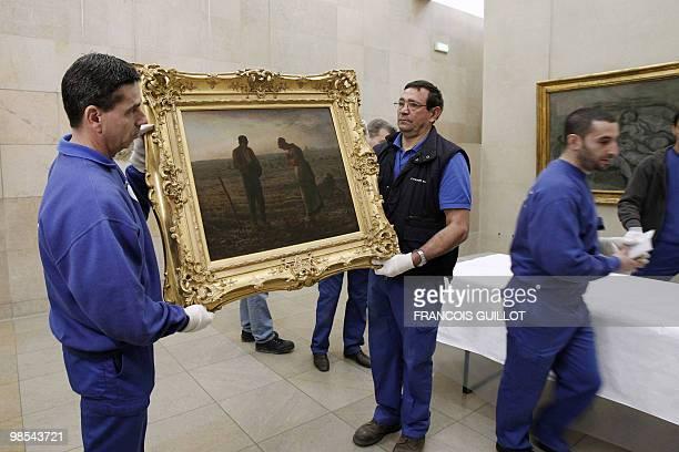 POUR L'ANGELUS DE MILLET L'HEURE DU DEPART POUR SHANGHAI A SONNE Staff members of the Orsay museum pack L'Angelus a painting by French JeanFrancois...