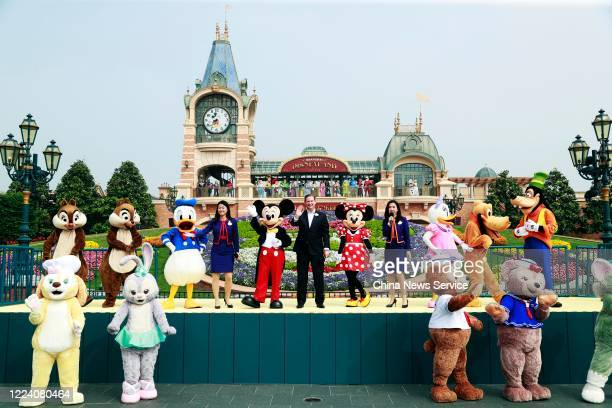 Staff members perform during a reopening ceremony of Shanghai Disney Resort after the coronavirus pandemic on May 11 2020 in Shanghai China Walt...