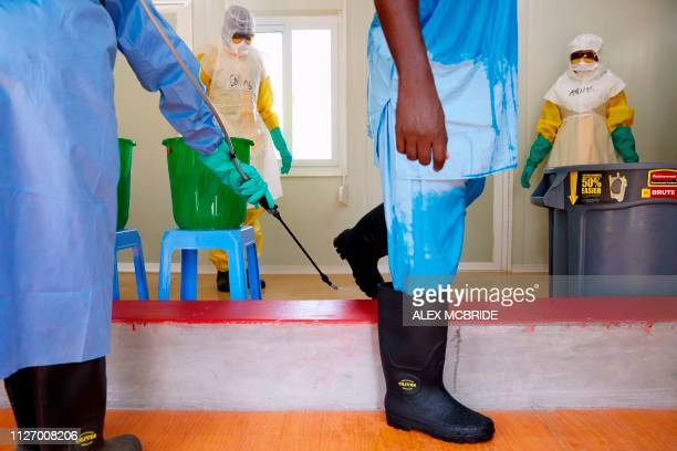 Staff members practise disinfecting themselves while carrying out infection prevention and control training in Juba, South Sudan on February 21,...
