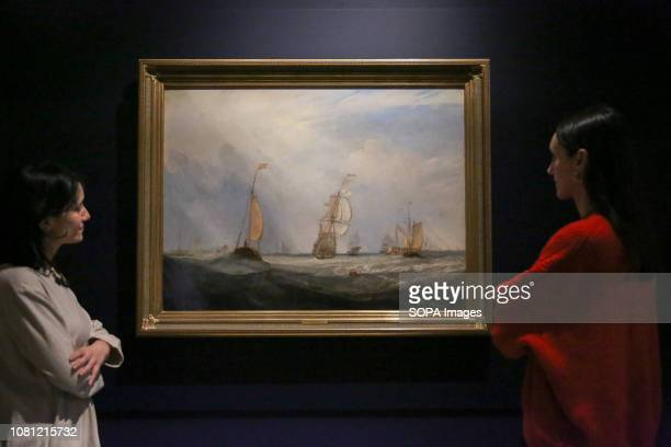 Staff members seen viewing a painting by JMW Turner The Royal Academy Schools most illustrious graduates exhibits Helvoetsluys 1832 by JMW Turner and...