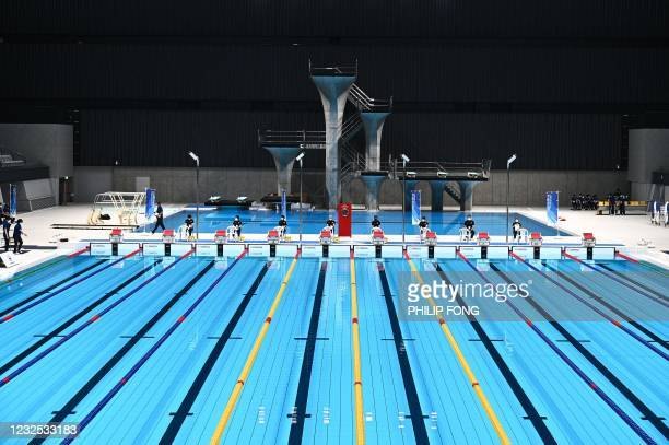 Staff members stand by ahead of the para swimming test event at Tokyo Aquatics Centre, the venue for Tokyo 2020 Olympic and Paralympic Games in Tokyo...