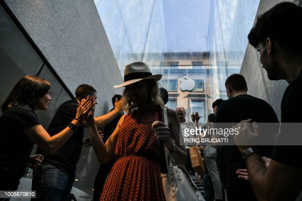 Staff members welcome customers on the opening day of the new Apple Store Liberty the first Italian flagship store of Apple in Milan on July 26 2018