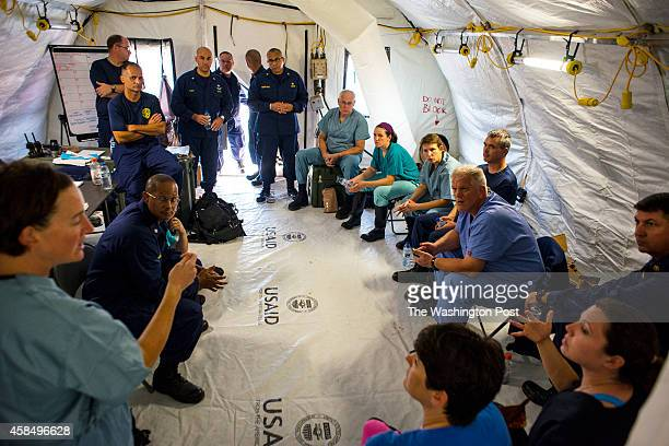 Staff members with the US Public Health Service meet inside the Monrovia Medical Unit on Tuesday November 4 2014 in Monrovia Liberia The MMU will be...