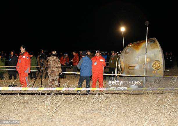 Staff members work on the capsule of Shenzhou8 spacecraft on November 17 2011 in Siziwang Banner Inner Mongolia Autonomous Region of China The...