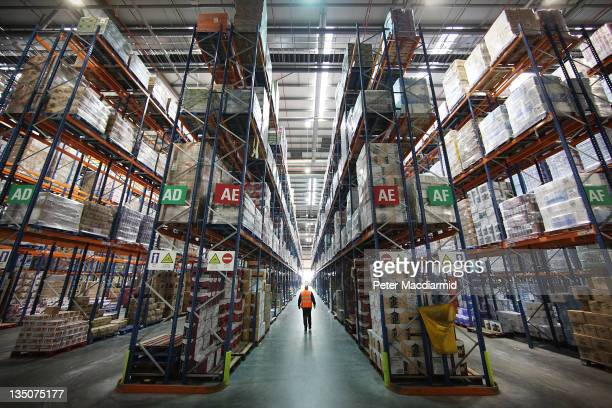 Staff move among the goods stored at Sainsbury's Waltham Point distribution depot on December 6 2011 in Waltham Abbey England The depot is the...