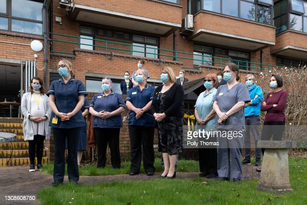 Staff of a Marie Curie hospice take part in a minutes silence on March 23, 2021 in Penarth, United Kingdom. Marie Curie Cancer Charity has organised...