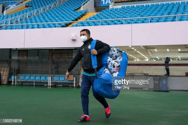 Staff of Buriram United wearing a mask walks into the stadium during a training session prior to the AFC Champions League Preliminary Round match...