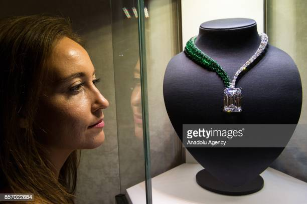 A staff of Christies is seen near a 404 caratrough diamond discovered in early 2016 and transformed by de GRISOGONO in Geneva in London England on...