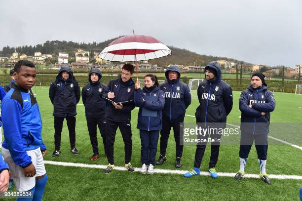 Staff of FIGC in the Centro Sportivo Parco Don Alberto Seri with participants during an event as the Italian Football Federation unveil the new...