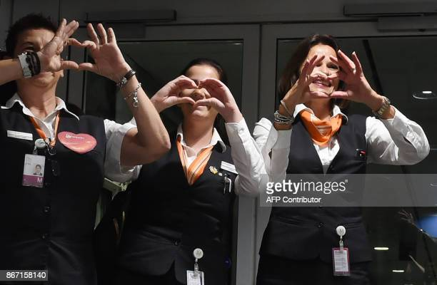Staff of German airline Air Berlin make heart signs at FranzJosefStrauss airport in Munich southern Germany ahead of the last scheduled flight on...