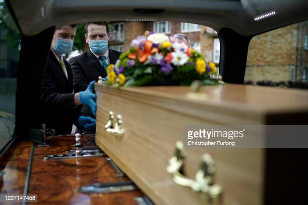 Staff of Guardian Funerals transport the casket of Covid-19 victim Dennis Clapham, aged 62, to Nab Wood Crematorium on May 26, 2020 in Shipley, West...