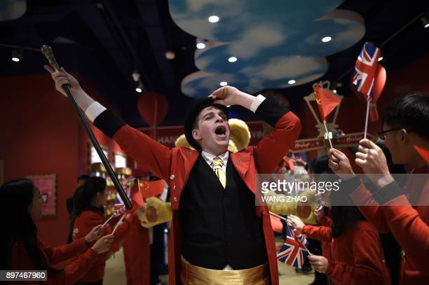 TOPSHOT Staff of Hamleys welcome guests on the opening day of a new Hamleys store the iconic British toy retailer now Chineseowned in Beijing on...