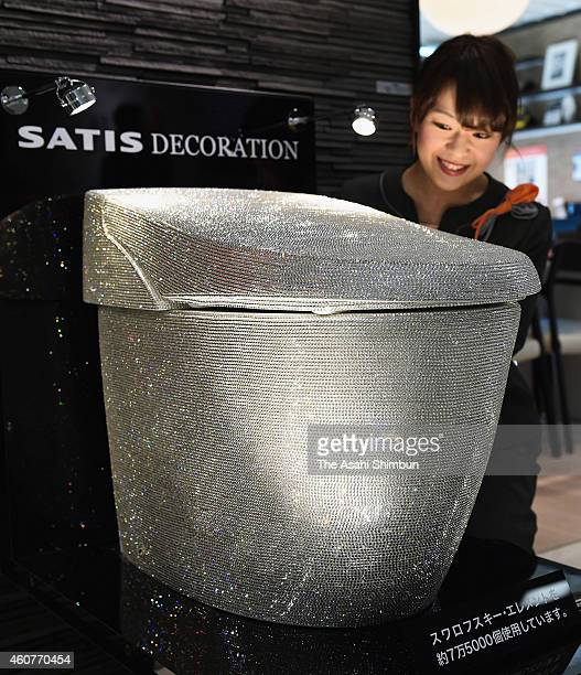 A staff of housing equipment company Lixil Corp introduces a basin decorated with 75000 Swarovski crystals at the company showroom at Grand Front...