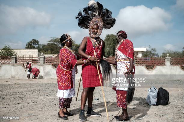 Staff of Kajiado county government prepare their Maasai tribe costumes for their cultural performance before Kajiado half Marathon calling for peace...
