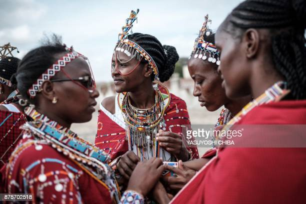 Staff of Kajiado county government prepare their traditional Maasai tribe accessories for their cultural performance before Kajiado half Marathon...