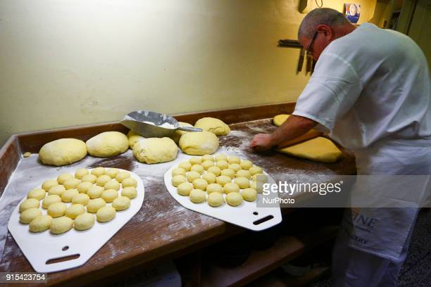 A staff of Krakow's wellknown bakery 'Cichowscy' produces donuts for Fat Thursday Fat Thursday is a traditional Catholic Christian feast on the last...