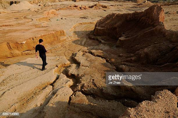 A staff of mine is seen at the site of a rare earth metals mine at Nancheng county Jiangxi province October 31 2010
