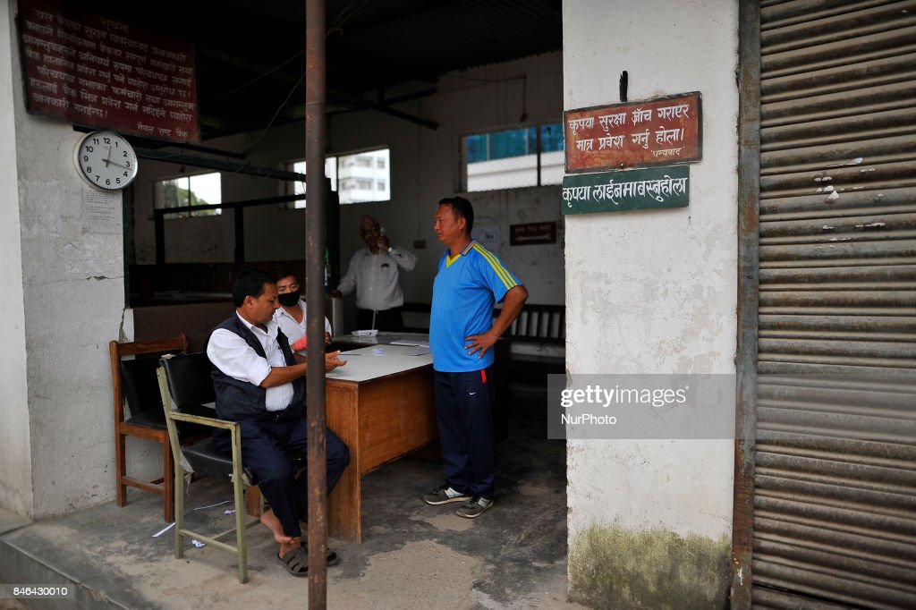 Staff of Nepal Rastra Bank awaits people to give token to exchange new notes for the Biggest Dashain Festival in Kathmandu on Wednesday, September 13, 2017. The central bank said for general public can exchange as much as Rs 27,000 each from its Currency Management Division.
