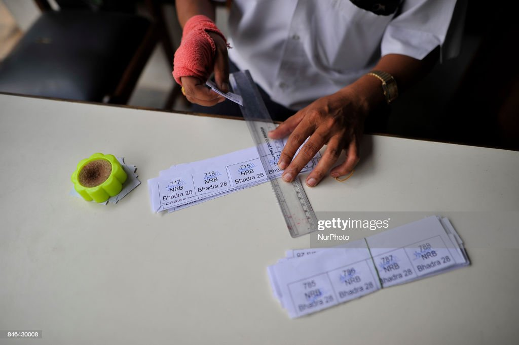 A Staff of Nepal Rastra Bank manage token for the people to exchange new notes for the Biggest Dashain Festival in Kathmandu on Wednesday, September 13, 2017. The central bank said for general public can exchange as much as Rs 27,000 each from its Currency Management Division.