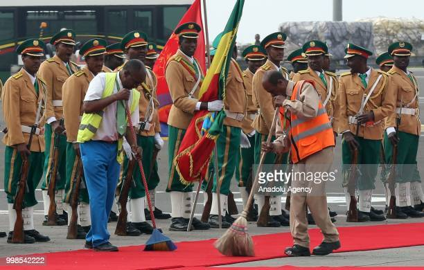 Staff of the Addis Ababa Bole International Airport clean and prepare the area for the arrival of the Eritrean President Isaias Afewerki after 20...