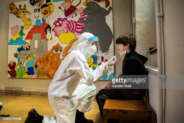 Staff of the bar Ritter Butzke takes a rapid antigen test at a COVID-19 testing station set up in the Ritter Butzke Bar in district Kreuzberg on...
