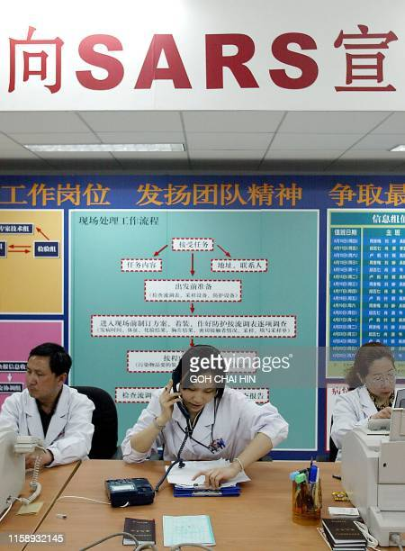 Staff of the Beijing Center for Disease Control man hotline phones, taking calls from the public concerning the Severe Acute Respiratory Syndrome ,...