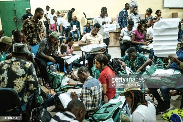 Staff of the Independent National Electoral Commission checks electoral materials before delivering to polling stations in less than three hours to...