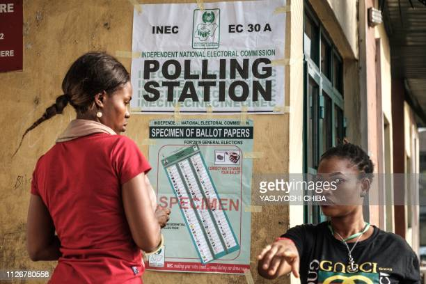 Staff of the Independent National Electoral Commission set up a polling station after the scheduled opening time of the voting for the Presidential...