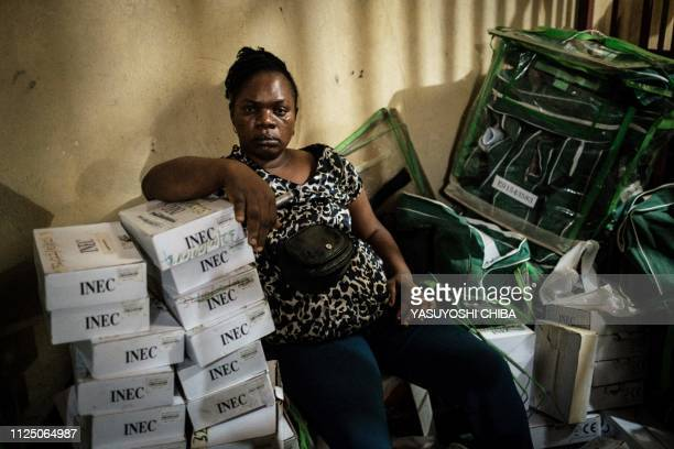 A staff of the Independent National Electoral Commission sits with items which are to be brought to a polling station at their local office in Port...