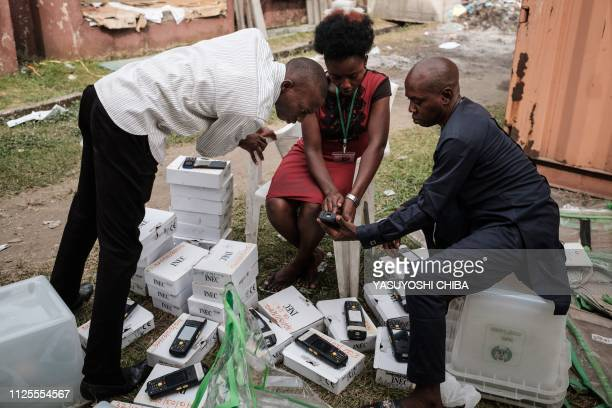 TOPSHOT Staff of the Independent National Electoral Commission start confirming over again 7000 portable permanent voter card readers ahead of the...
