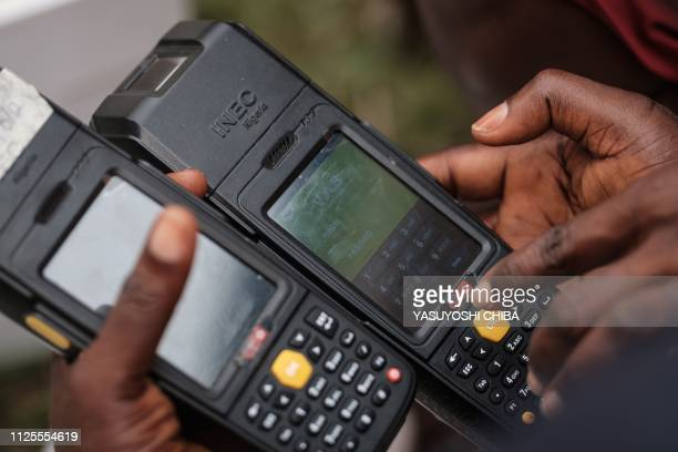 Staff of the Independent National Electoral Commission start confirming over again 7000 portable permanent voter card readers ahead of the postponed...