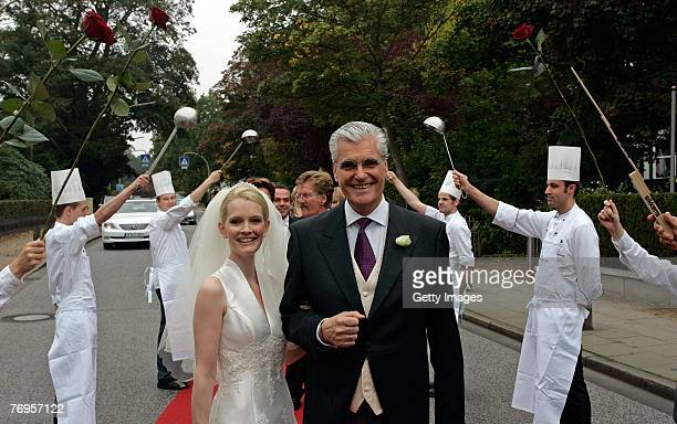 Staff of the Louis C Jacob Hotel in Nienstedten forms a guard of honor for Sky and Mirja Dumont who came to the famous hotel after their wedding...