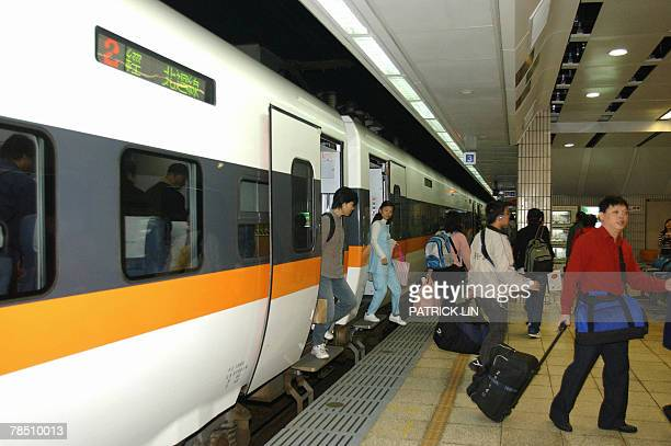 """Staff of the Taiwan Railway Administration stand guard after a Japan-made train """"Taroko,"""" arrives in the Taipei main station, 17 December 2007. The..."""