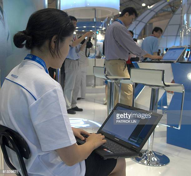 A staff operates a laptop at a booth of Asia's biggest computer show also known as 'Computex' in Taipei on June 2 2008 More than 1700 exhibitors will...