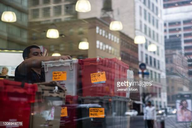 A staff organizes freshly arrived vitamins and other supplies at a convenience store on March 13 2020 in New York City President Donald Trump is...