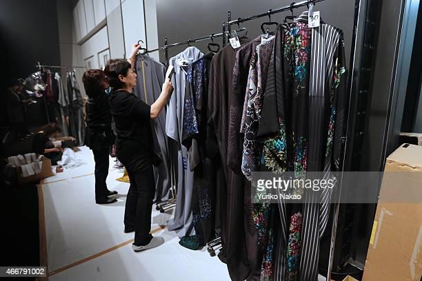 Staff organizes kimonos at backstage ahead of the JOTARO SAITO show as part of Mercedes Benz Fashion Week TOKYO 2015 A/W on March 19 2015 in Tokyo...
