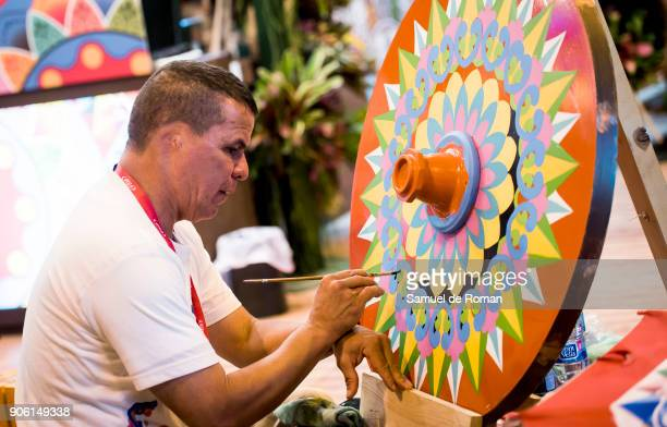 Staff painting a traditional design from Costa Rica at FITUR International Tourism Fair 2018 at Ifema on January 17 2018 in Madrid Spain Prime...